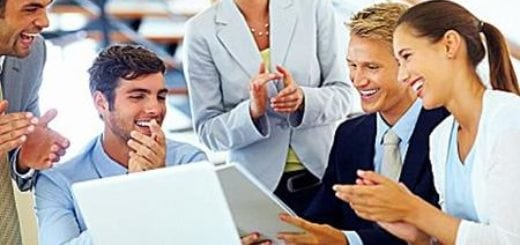 Successful business people applauding to their leader during meeting
