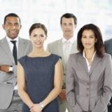 Group of successful business people standing together at office